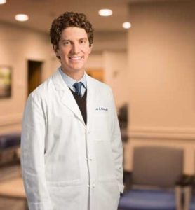 Dr. Cross in a white coat